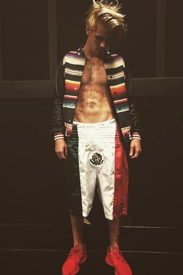 Justin Bieber wearing Saint Laurent T-Rex Tapestry and Leather Teddy Jacket, Nike Kaishi NS Sneakers, Calvin Klein Stretch Cotton Trunk Boxer, Title Boxing Boxing Mexico Flag Stock Trunks