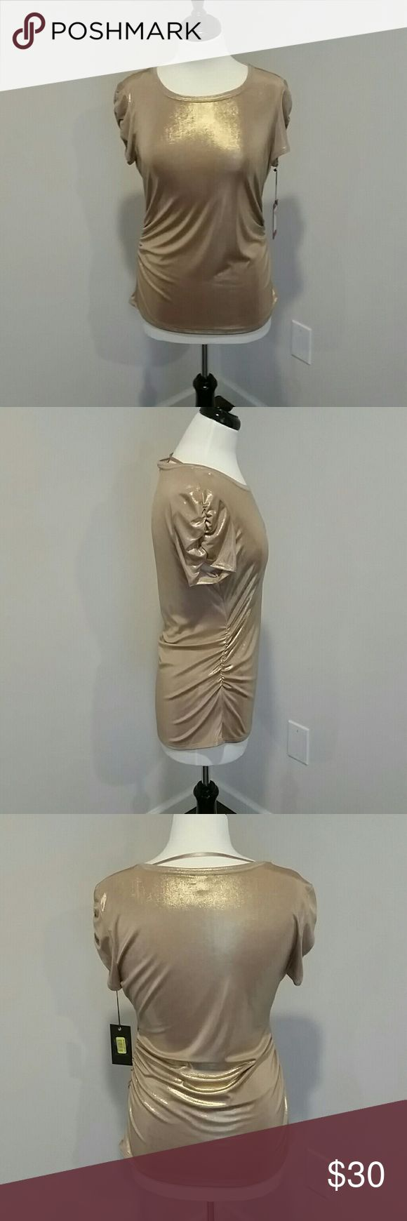 NEW VINCE CAMUTO GOLD METALLIC SHORT SLEEVE TOP GOLD METALLIC. CALLED GOLD LUSTER BY CO. A LOT OF RUCHING ON SIDES AND ON SLEEVES. STRETCHY POLYESTER AND SPANDEX  BLEND. SEMI LONG LENGTH COULD WEAR WITH LEGGINGS,  PANTS, SKIRTS.  VERY CUTE . VINCENT CAMUTO Tops Tees - Short Sleeve