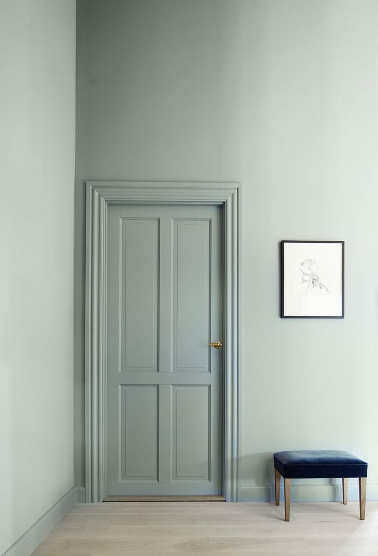 Restful green walls. By painting the door the same colour it continues and strengthens the feel of the space.: