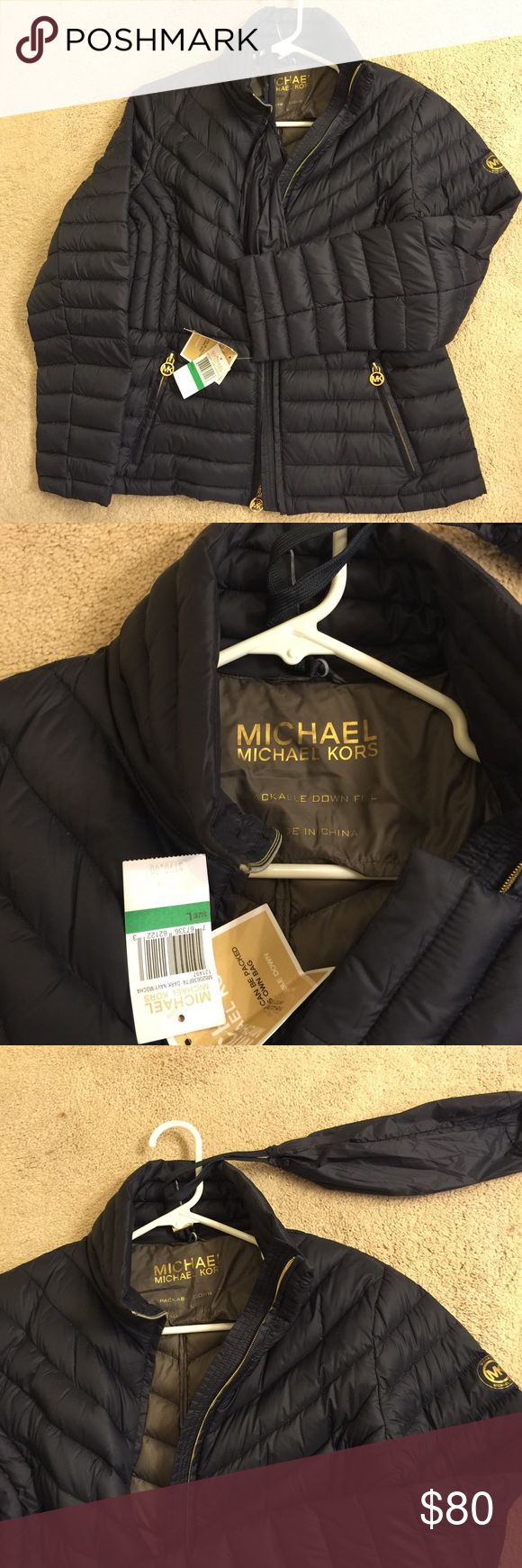 Michael Kors Jacket Michael Kors Downfill Jacket, size Large, new with tags, comes with storage bag (see attached in pic) Michael Kors Jackets & Coats Puffers