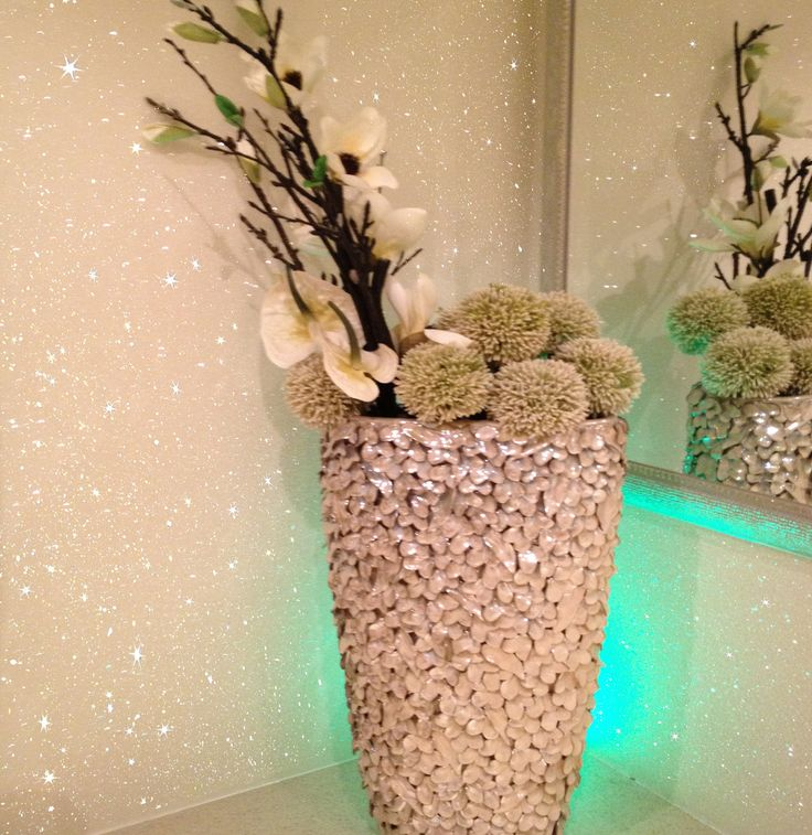 A textured, Sparkly White Glitter Wallpaper for home interiors. Sold by the meter and extra wide, our fabric backed shades of White glitter wallpaper for walls is the perfect wallcovering to add a touch of glam and opulence to your interior. Our shades of white include: Cream Sparkle wallpaper & White sparkle wallpaper which are among the top designs in our best selling embossed sequin collection. As this is a bespoke product that is cut to the required length it is non-returnable. Pleas...