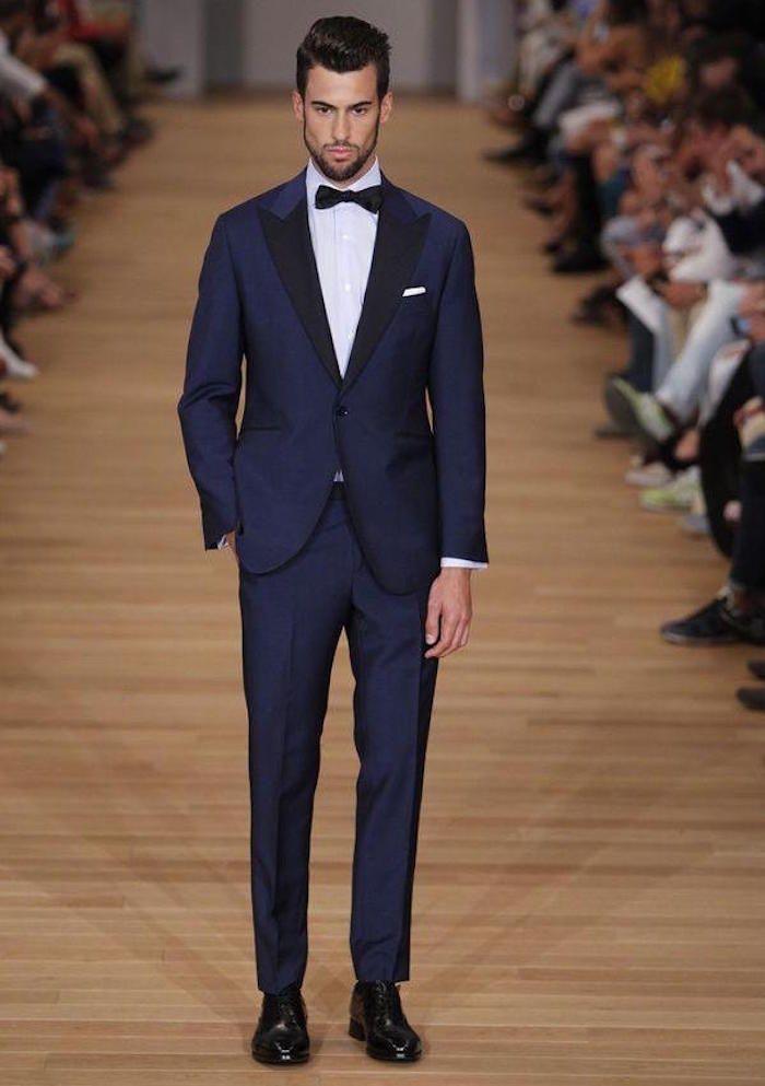 Le costume bleu marine homme – élégance et sobriété  9fef3486042