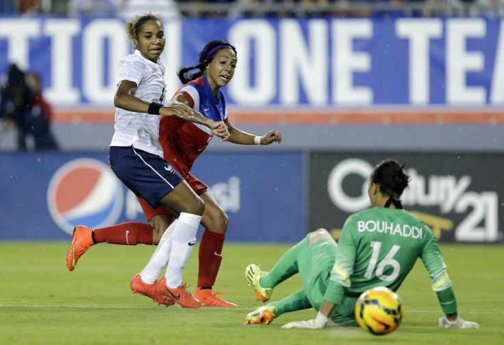 Sydney Leroux beats defender Laura Georges and goalkeeper Sarah Bouhaddi for the only goal in a 1-0 victory over France on June 14, 2014, in Tampa. (Chris O'Meara/AP)