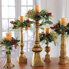 Christmas candles with greenery