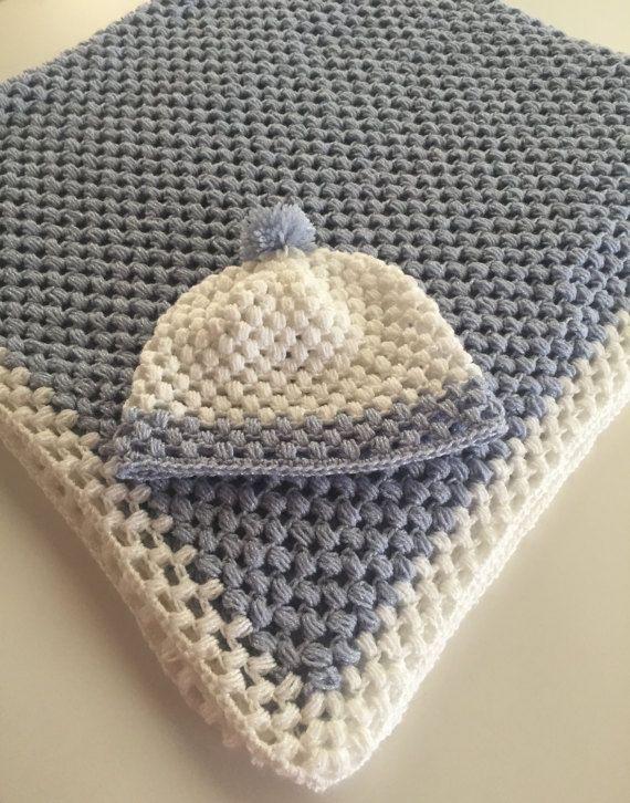 "Beautiful crochet baby blanket and hat set in soft pastel blue and white. this blanket it has been made with high quality soft baby yarn. Ideal for using with a Moses basket, push chair or car seat. Makes a lovely gift for a new baby.  Measurements: Blanket 39,37"" x 39,37"" (100 cm x 100 cm)  Hat: 0 – 3 months  Care instructions : Gently hand washed and laying flat to dry. However, it can be machine washed at 30 degrees if you prefer.  Please contact me if you need another size ,color…"