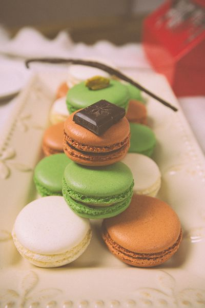 Vanilla, chocolate and pistachio macarons