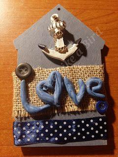 """Sagoma casetta decorata con nastri, bottoni e scritta """"Love"""" in fimo realizzata da me - Ilaria Free Like a Bird"""
