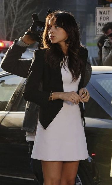 Ashley wearing white dress with black tailored blazer