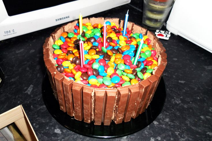 Kit Kat and M&M birthday cake. The top could be mini Reeses cups, too...I'm just sayin.