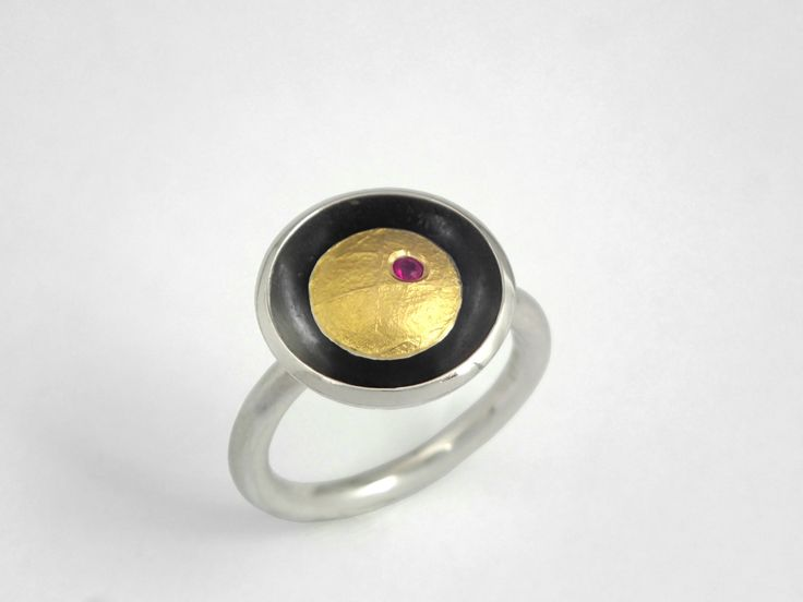Modern round gold and oxidized silver ring decorated with a genuine ruby and a rough golden surface. by TomisCraft on Etsy