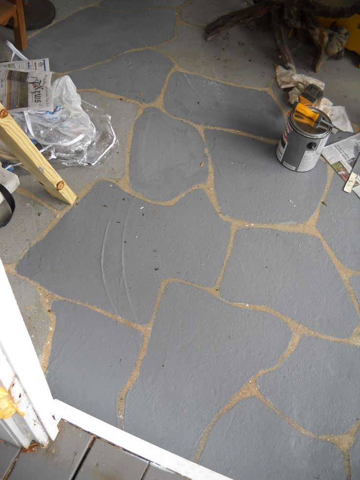 the ver early stages of faux painting concret floor.