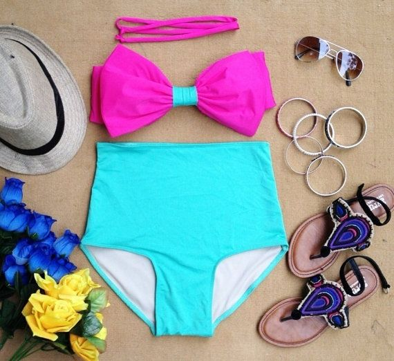I wonder if I could pull off the high waisted swim suit...maybe it would hide my pudge! :)