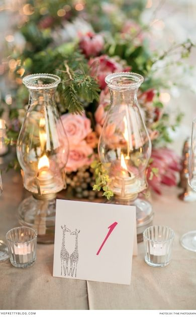 Lanterns and a cute giraffe illustration for table decor | Photographers: Tyme Photography