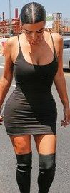 Kim Kardashian West marvelled at her tiny waist while taking a wardrobe selfie in a LBD on Wednesday.