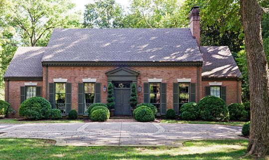 very symmetrical exterior with entry door front and center