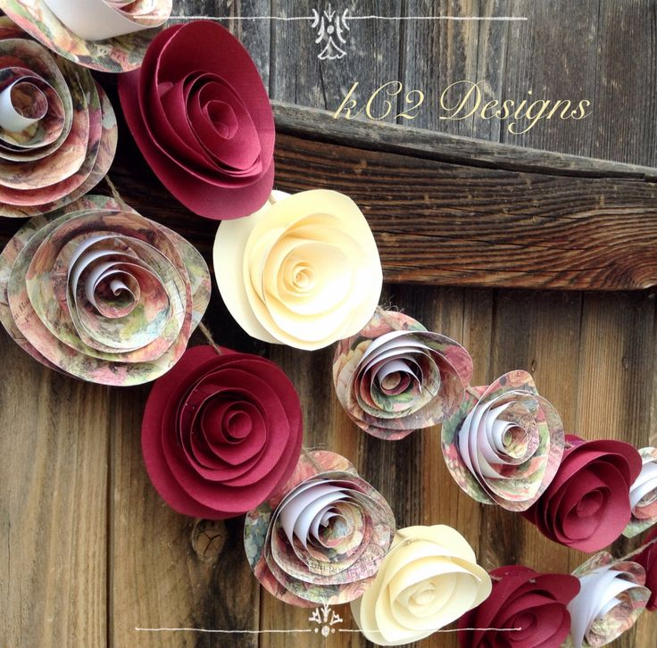 This garland is made of high quality paper in beautiful rich reds, ivories, and floral print paper. Each paper rose is hand cut and sculptured and measures between 2 and 2 1/2 inches, they're attached