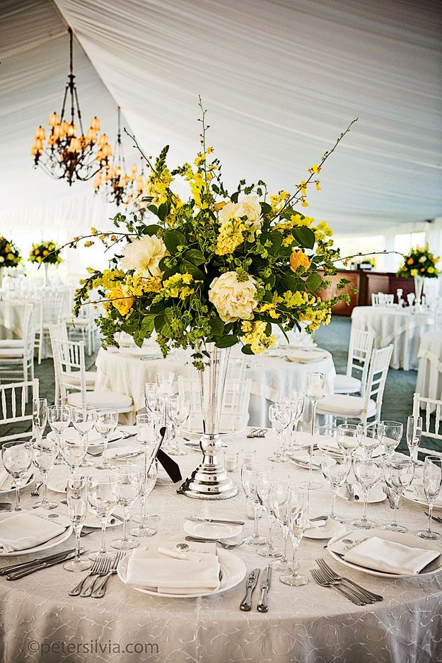 17 best ideas about yellow flower arrangements on for Wedding reception centrepieces