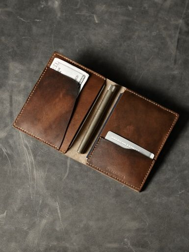 """Travel well and travel smart with our """"Magellan"""" chocolate brown leather double passport wallet."""