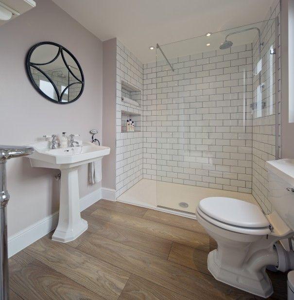 Light Purple Bathroom Walls White Subway Tile Shower Wood Floors Pretty Romantic Bathroom Wood Floor Bathroom Small Bathroom Bathroom Design