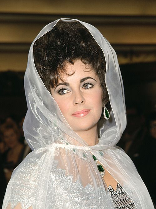Elizabeth Taylor at the Royal Gala opening of Taming of the Shrew in London, 1967 by Reginald Davis (by Andrew Garth)