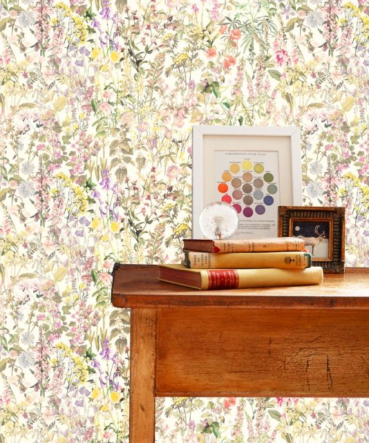 Charlotte Wallpaper A beautiful wallpaper with multicoloured meadow flowers taken from hand painted archive images created for 'The Ladybird book of Wildflowers' first published in 1957. The design has an ethereal sunlit quality to its soft floral shades and brings nature to walls in the most natural yet beautifully sophisticated way.