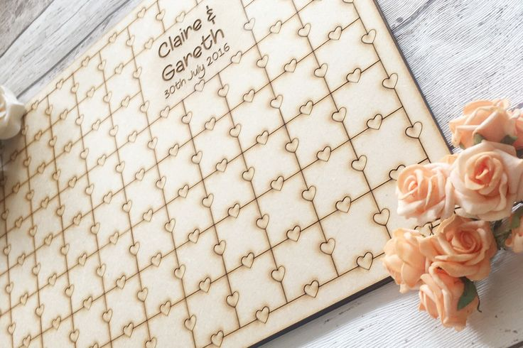 A personal favourite from my Etsy shop https://www.etsy.com/uk/listing/276899988/wedding-puzzle-guestbook-jigsaw