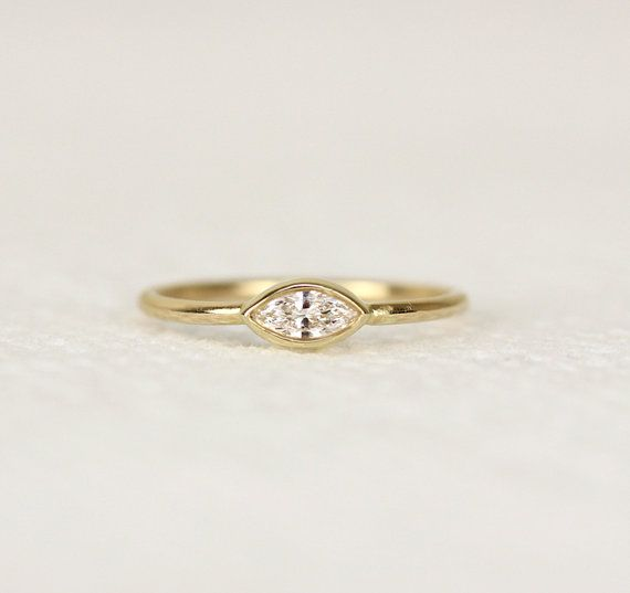 Hey, I found this really awesome Etsy listing at https://www.etsy.com/listing/239853886/marquoise-diamond-engagement-ringsimple