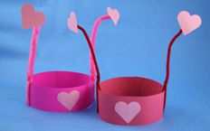 Love Bug Boppers: Make this adorable headband and wear it for the one you love! Love Bug Boppers are an easy Valentine's Day craft for kids.