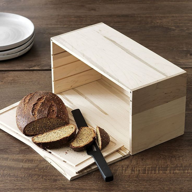 Dream kitchen idea: this stylish, functional bread box. It has a built-in cutting board! Would look beautiful on a kitchen counter.