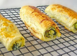 Feta Ricotta and Spinach Roll ~ mix feta, ricotta and spinach; spread onto square of puff pastry, seal edges with eggwash, roll, brush top with eggwash; place rolls on parchment, bake, turn if necessary to achieve golden brown all around; cool on wire rack, serve hot or room temperature, enjoy