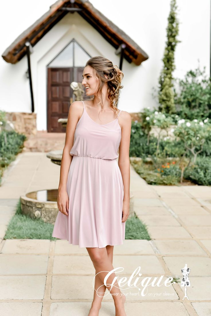 Leah Gelique bridesmaids dress. Soft , dusty pink dress. Soft and sweet bodice and a flowing skirt bridesmaids dress. Available in a variety of sizes and colours from Brides of Somerset. Long, knee-length or short available. Knee length bridesmaids dress.