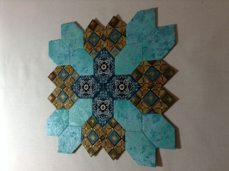 Liz Forney's Lucy Boston Patchwork of the Crosses.   Teal and brown block.