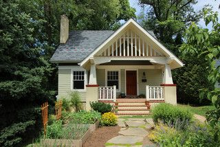 Cottage makeover with design in roof, raised beds in front yard