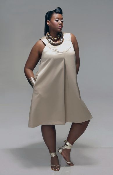 Summer fashion trends for the plus size woman - San Francisco Plus-Size Fashion | Examiner.com--  I like the entire outfit..from the chuncky jewlery down to the sandles and the  color against her skin. NICE.  tk