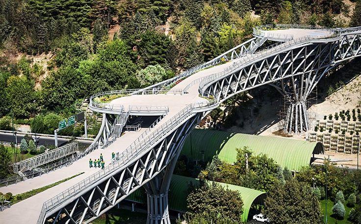 Tabiat Bridge (Nature Bridge) in Tehran, Iran - photo by Hamidreza Darjani/Nasimonline, via Wikipedia; The 890 feet long pedestrian bridge spanning Shahid Modares Expressway connects two public parks. The 3-level bridge was designed by Leila Araghian. It was completed in 2014.        https://en.wikipedia.org/wiki/Tabiat_Bridge