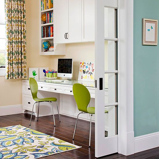 Double duty desk for kids with cabinets above for storage. Love the pops of green!