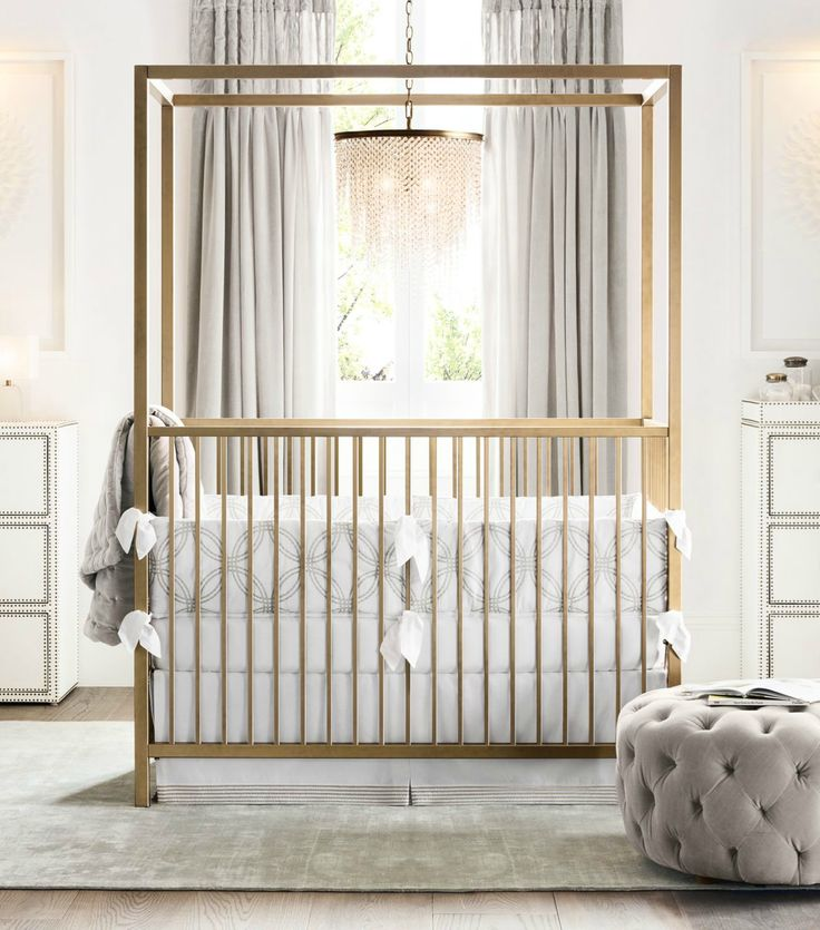 Clean-lined canopy crib. Aged-brass finish. A modern silhouette with a vintage sensibility.
