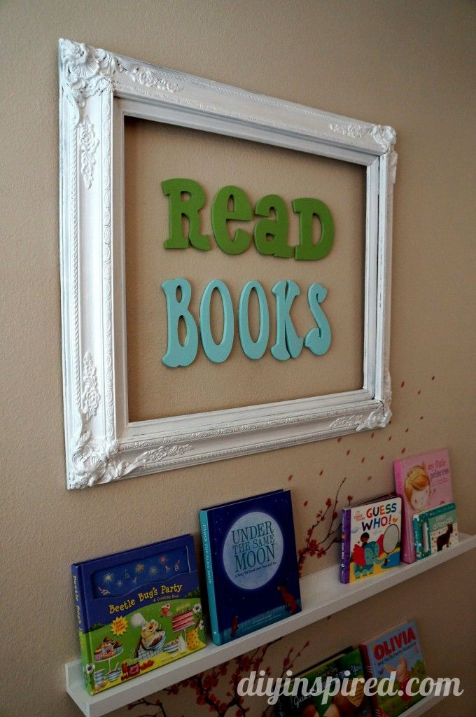 """Instead of wooden letters framed, my favorite Walt Disney reading quote in vinyl on the wall, """"""""There is more treasure in books than in all the pirates' loot on Treasure Island and best of all, you can enjoy these riches every day of your life."""""""