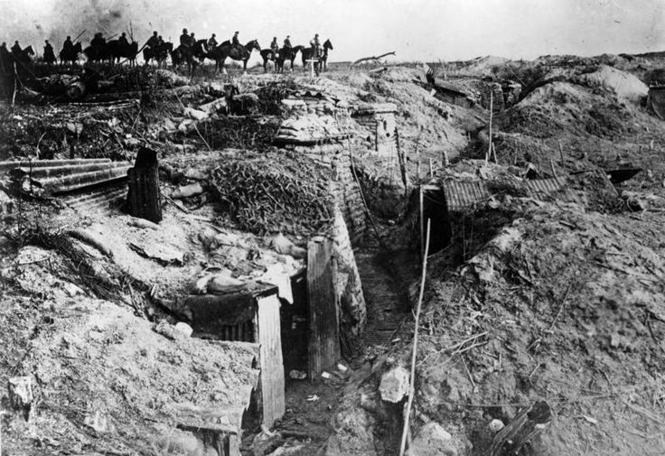 Germans passing a captured British trench during the Spring Offensive of 1918