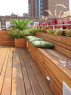 build into the deck, on the sides? High planter at back, bench in front (not to coop code...)