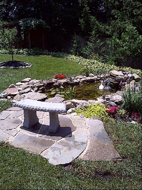 18 best water features by ponds patios and waterfalls co for Koi pond builders greenville sc