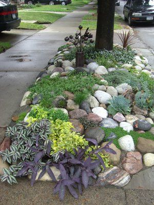 """Gardening ideas for a """"hell strip"""" -- just past the driveway? next to the shed? Keeps getting over-run with long crab grass... Cover it with weedblocker/ pebbles/ decorative rocks & add a few tough-to-kill perennials."""