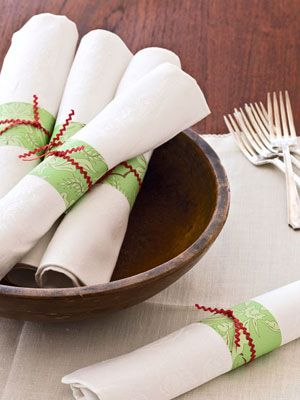 Make place settings look like a present with napkin rings crafted from leftover wrapping paper, rickrack, and double-sided tape. Get the easy instructions. #christmas #holiday #crafts