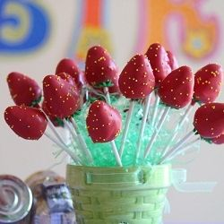 Strawberry Cake Pops: Strawberry cake enclosed in red candy shell with yellow