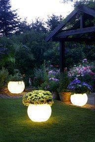 use rust-oleum glow in the dark paint on pots in the yard
