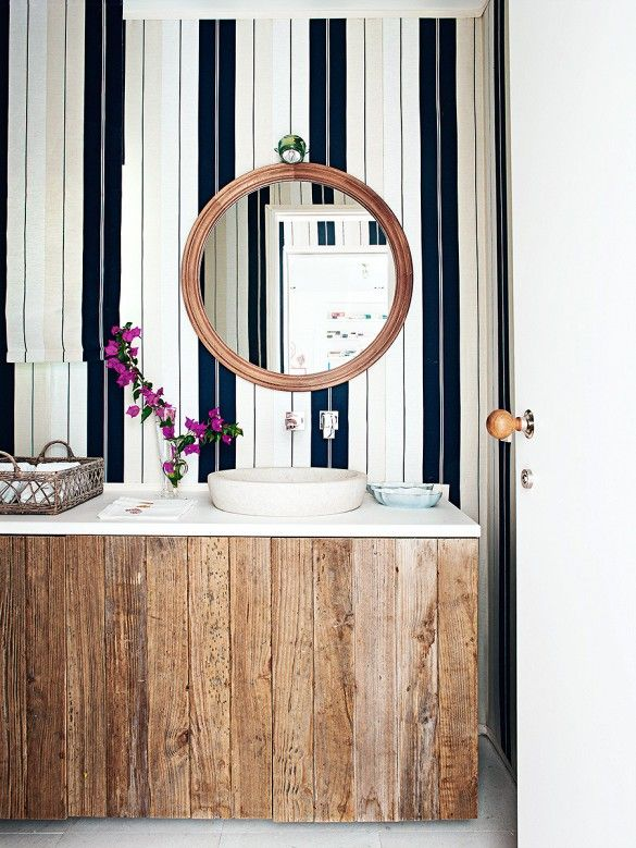 Striped wallpaper in rustic bathroom