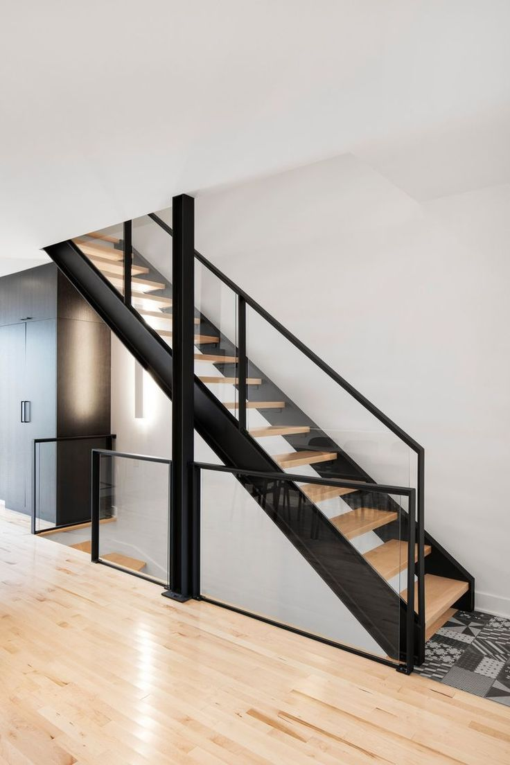 Custom-designed stairs of a town house unit in Canada.