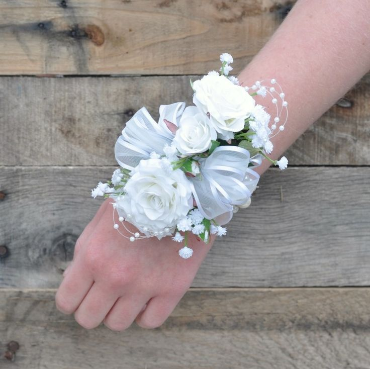 Sweetheart rose and babies breath corsage made with silk flowers for Prom or a Wedding.  Holly's Wedding Flowers.