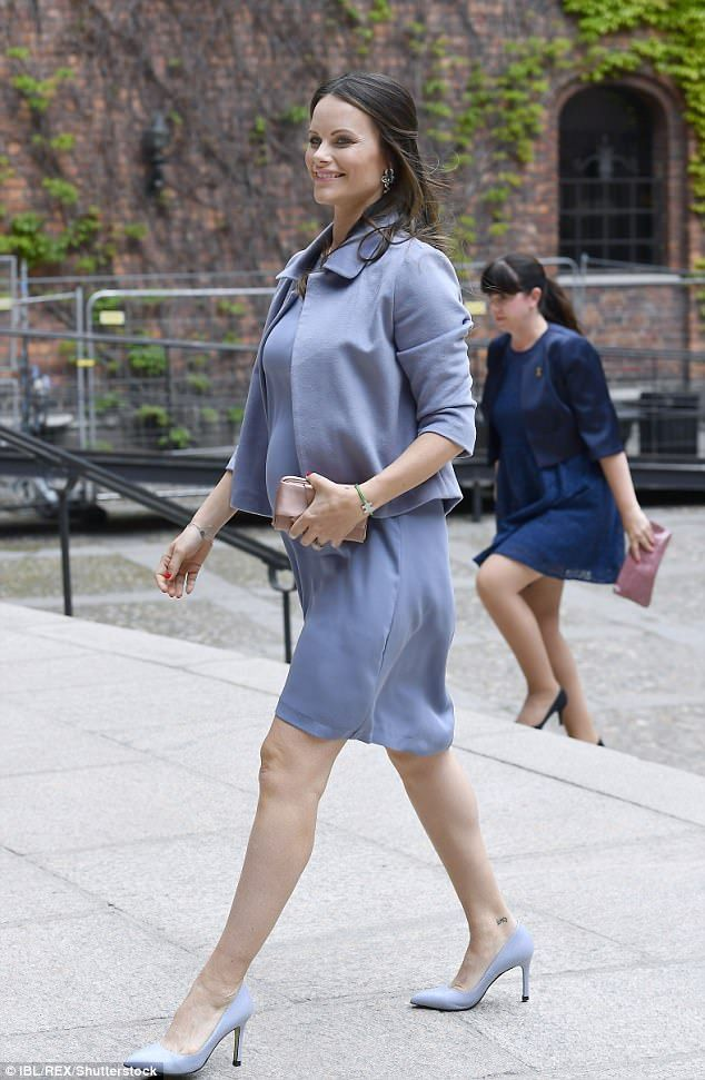 Bumping along nicely: Princess Sofia Of Sweden is clearly taking to pregnancy swimmingly as she headed to the graduation ceremony of the Sophiahemmet Hotel in Stockholm on Friday - during which she looked simply radiant