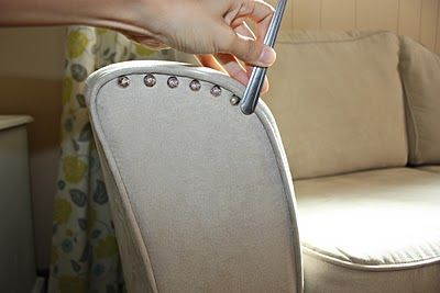 Glam up an Ikea couch with nail head trim.